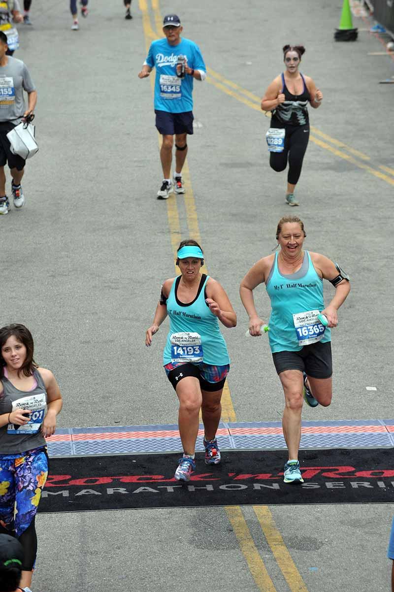 Jennifer and Jenna crossing the finish line